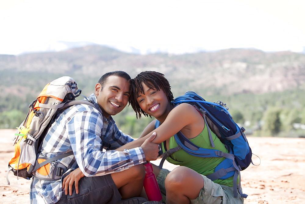 USA, Arizona, Sedona, Young couple hiking and enjoying desert scenery