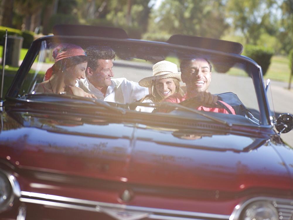 Friends driving convertible car