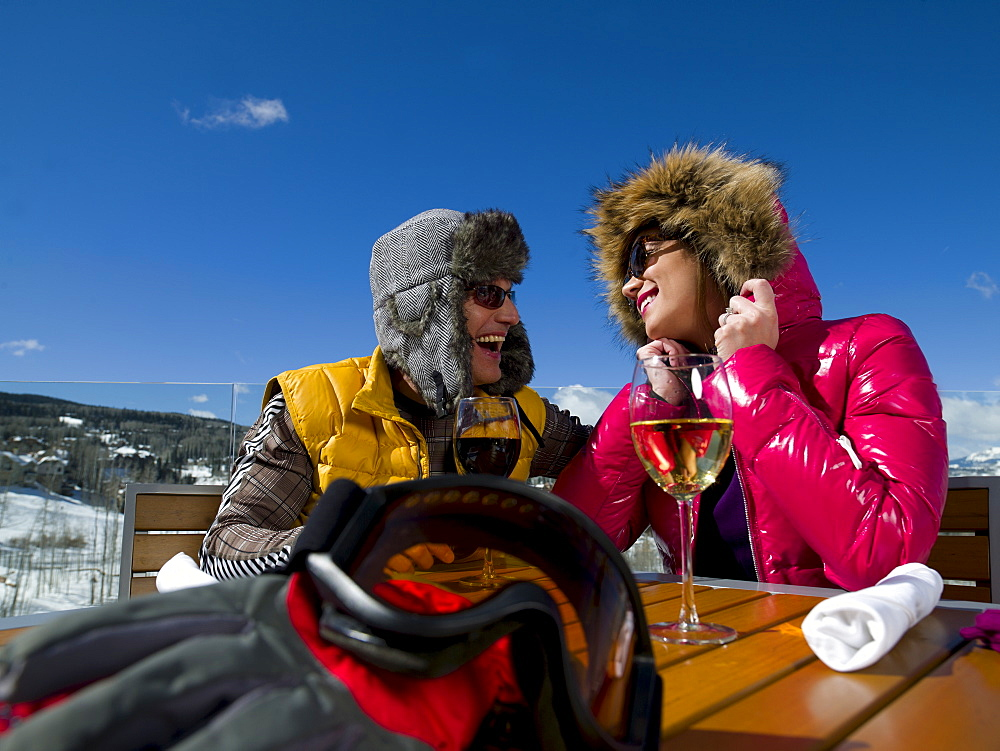 USA, Colorado, Telluride, Couple enjoying outdoor meal at ski resort