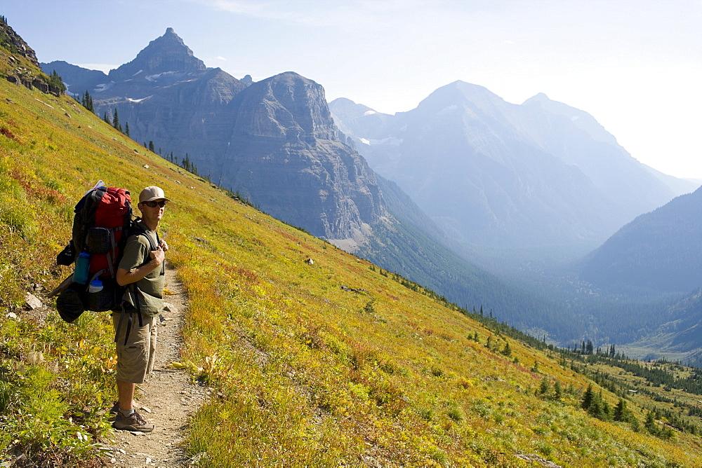 USA, Montana, Glacier National Park, Browns Pass, Mid adult hiker posing