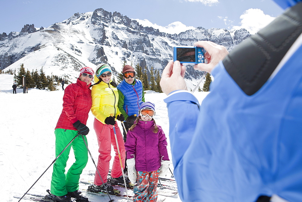 USA, Colorado, Telluride, Three-generation family with girl (10-11) posing during ski holiday