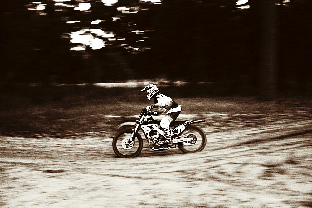 USA, Texas, Austin, Cross motorcyclist on sandy track
