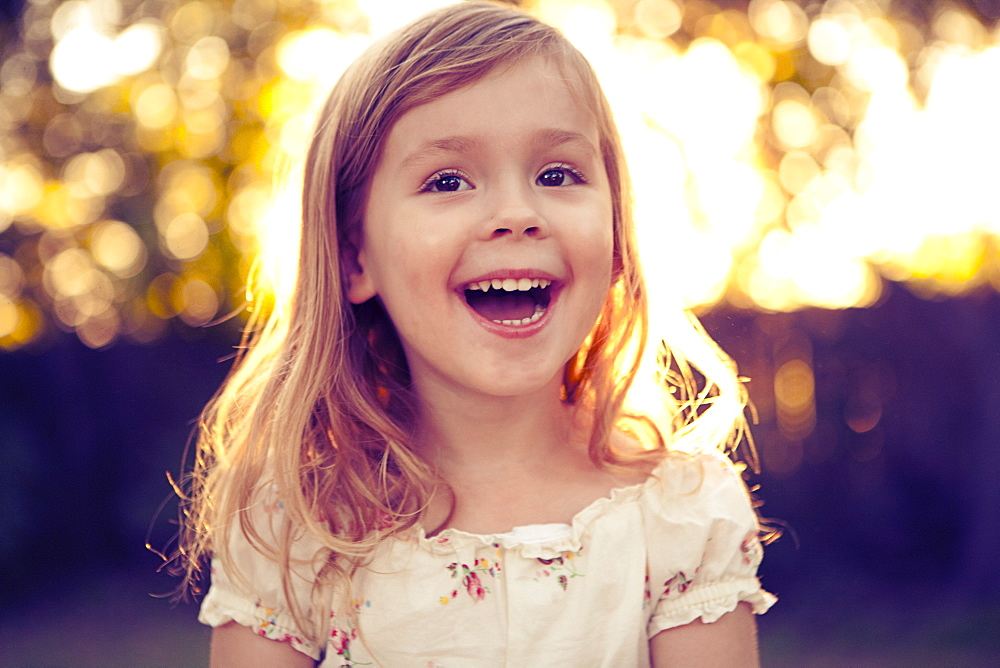 Portrait of girl (4-5) laughing