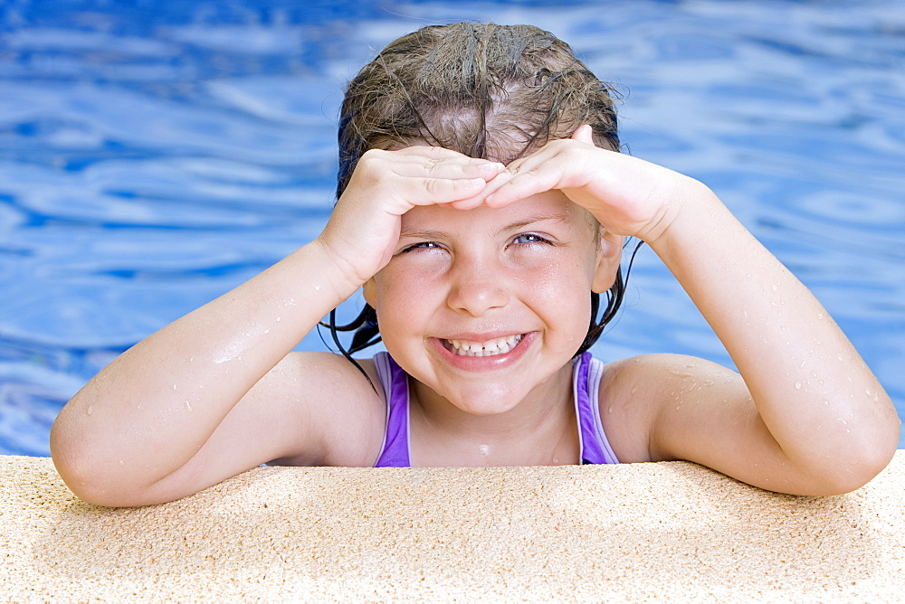 Spain, Costa Blanca, Portrait of smiling girl (6-7) in swimming pool