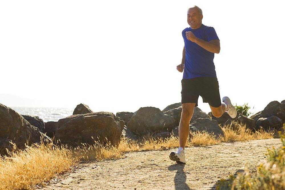 USA, California, Berkeley, Senior man jogging