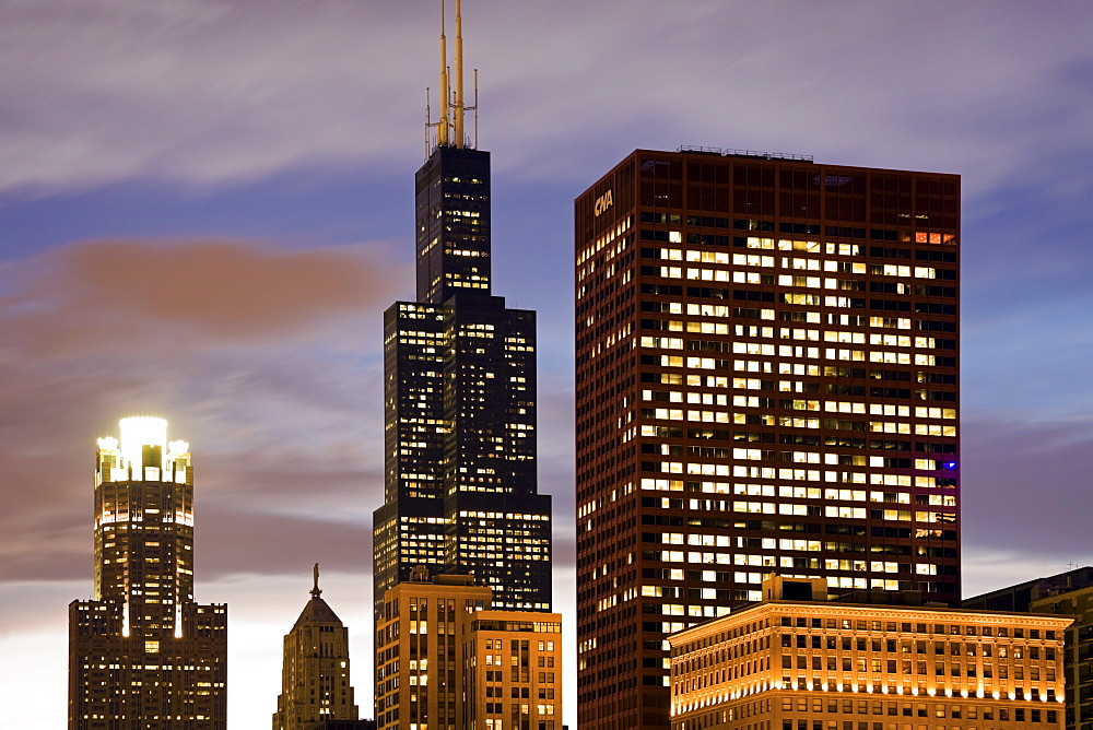 USA, Illinois, Chicago, Illuminated skyscrapers at dusk