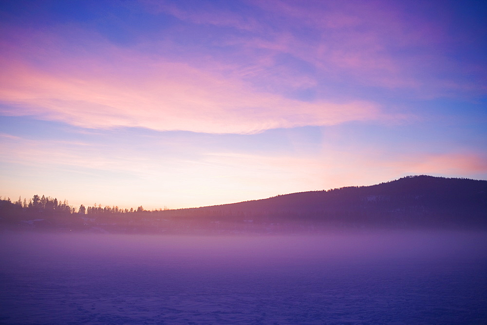 USA, Montana, Whitefish, Snow covered landscape at sunset