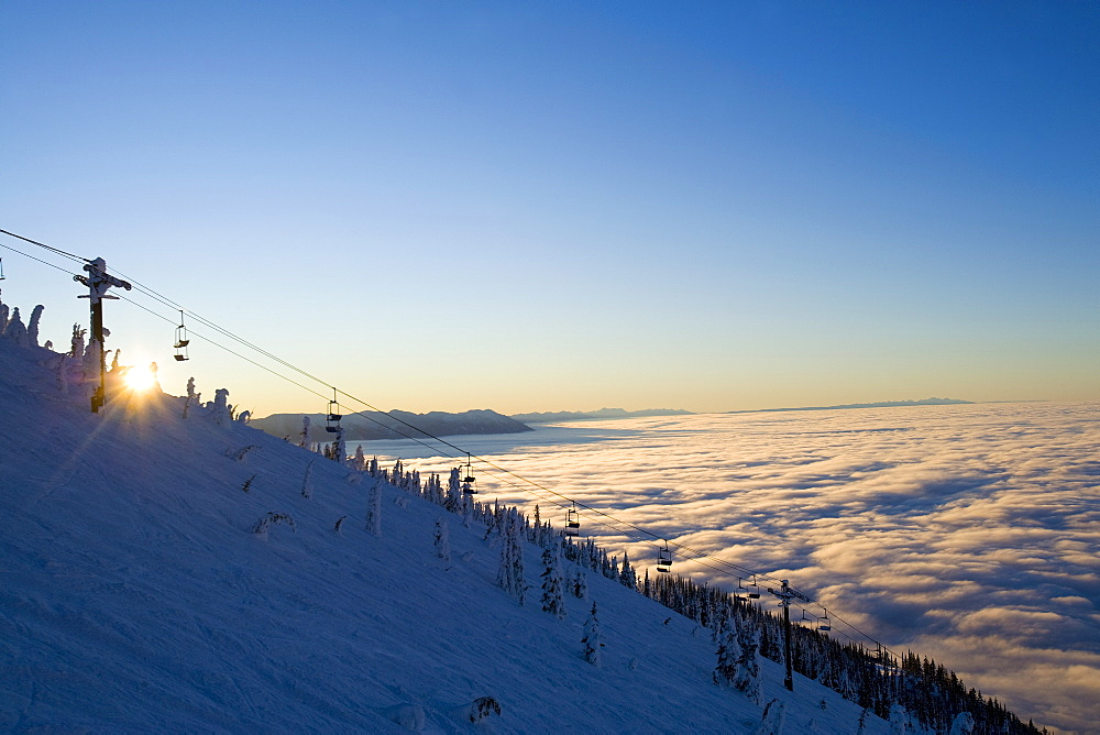 USA, Montana, Whitefish, Ski lift on mountain over clouds