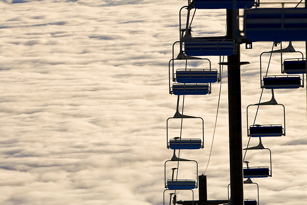 USA, Montana, Whitefish, Ski lift against clouds