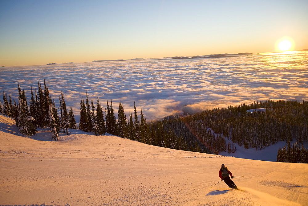USA, Montana, Whitefish, Mid adult woman skiing