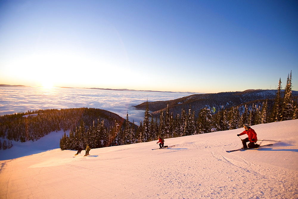 USA, Montana, Whitefish, Four people skiing