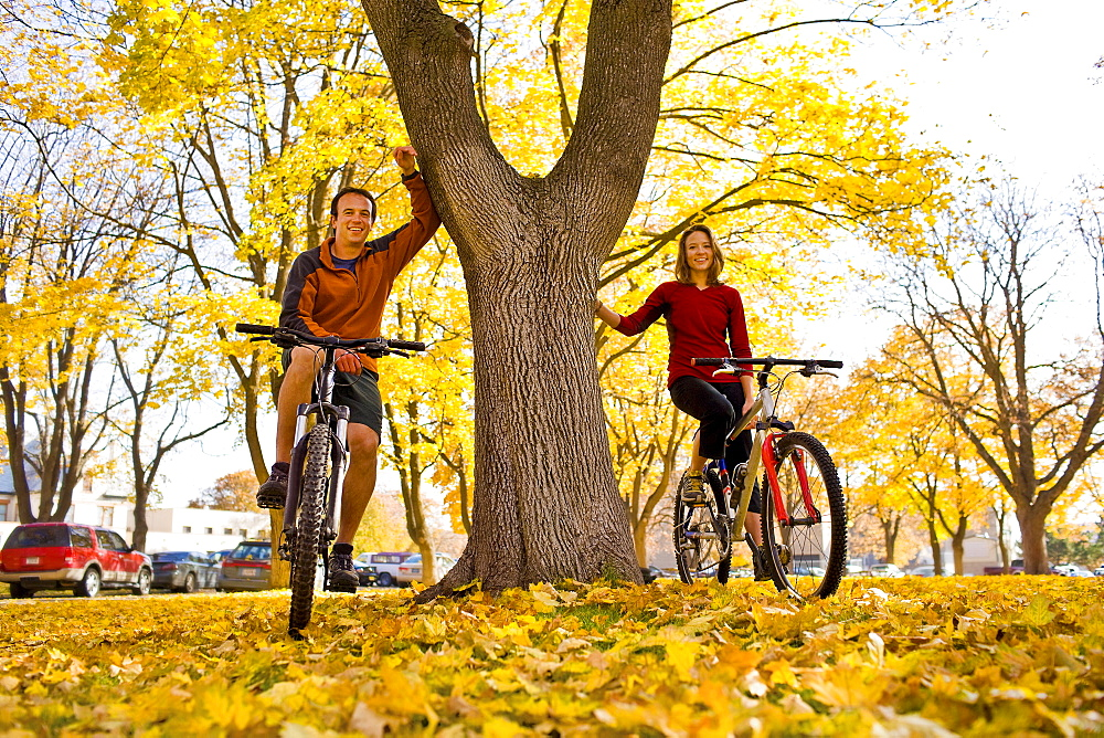 USA, Montana, Kalispell, Portrait of couple at bikes in park