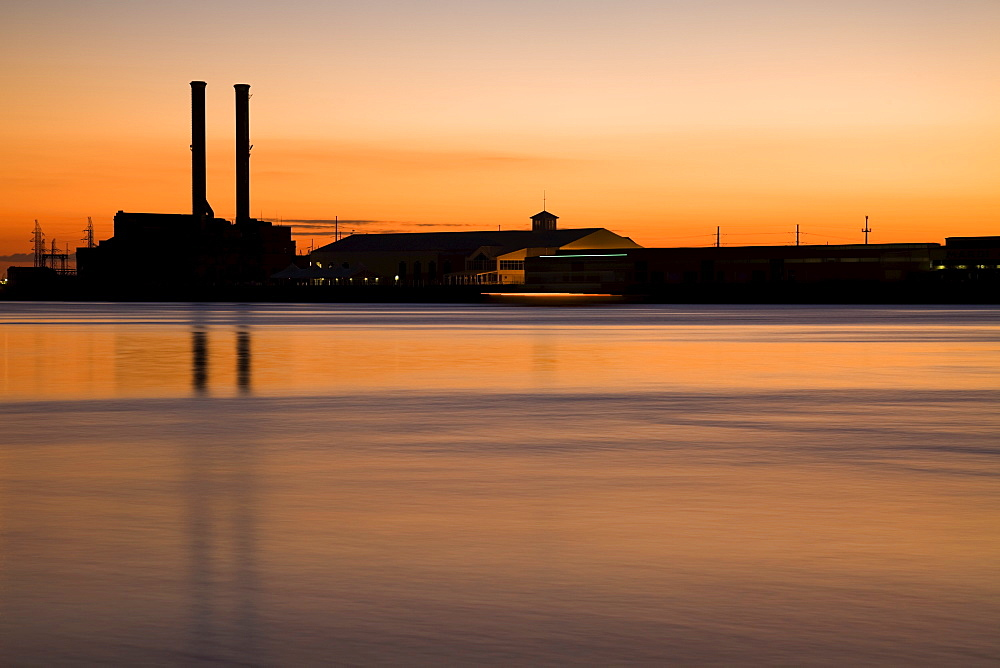USA, Louisiana, New Orleans, silhouette of smokestacks at lakefront