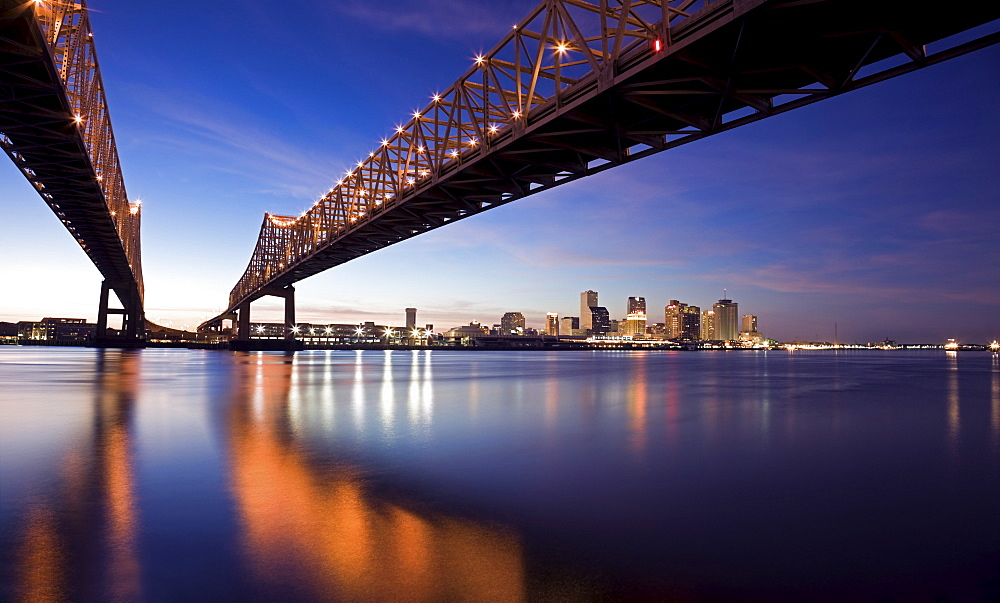 USA, Louisiana, New Orleans, Toll bridge over Mississippi River at sunset