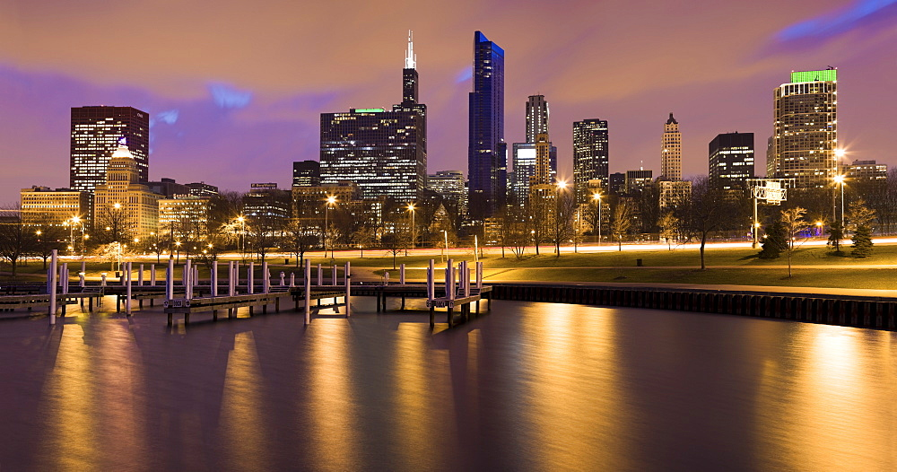 USA, Illinois, Chicago, City skyline and marina illuminated at dusk