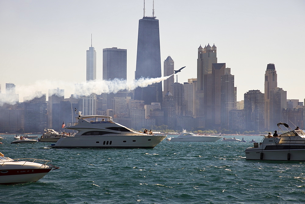 USA, Illinois, Chicago, motor boats and airplane with cityscape at background