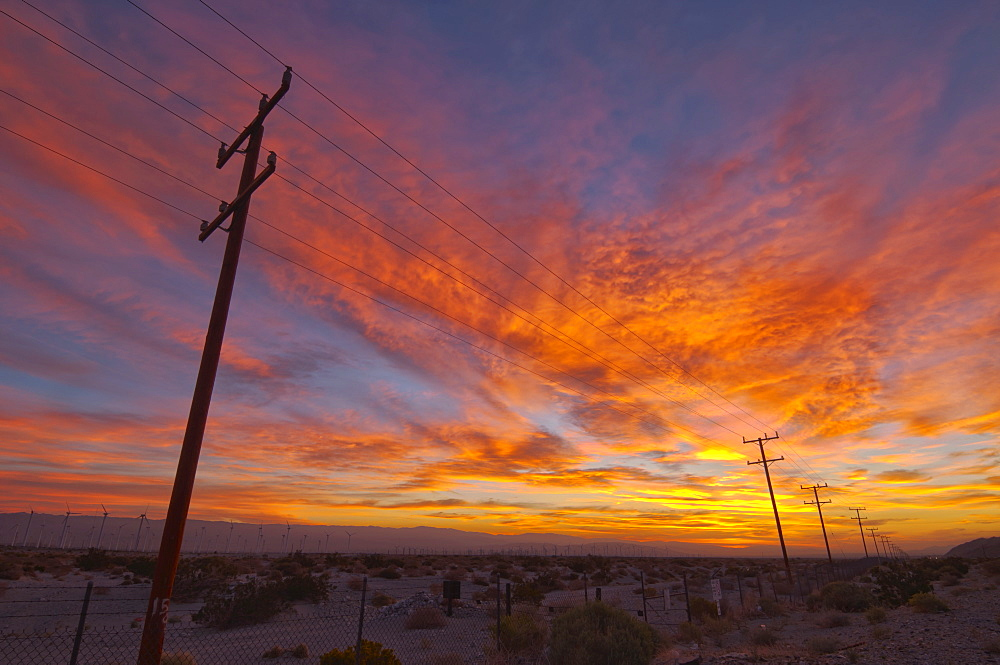 USA, California, Palm Springs, power line at sunrise