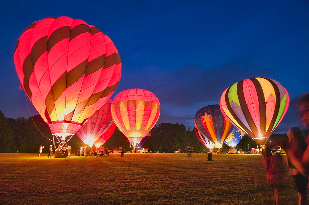USA, Ohio, hot air balloons taking off at night