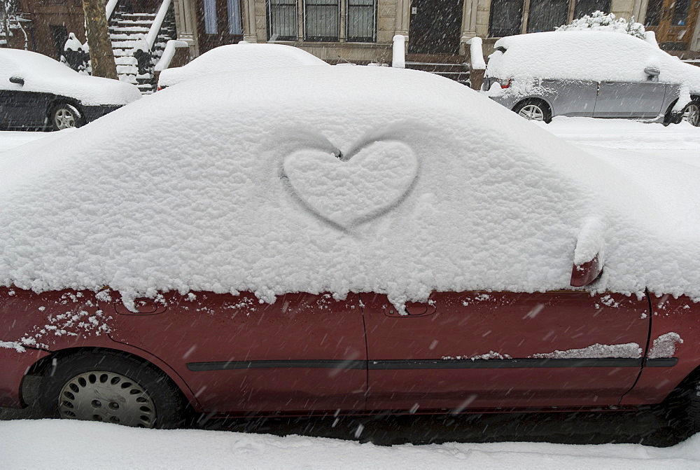 Heart shape in snow on car
