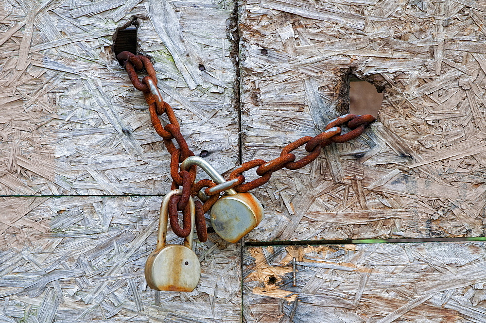 Chain and padlocks on old door