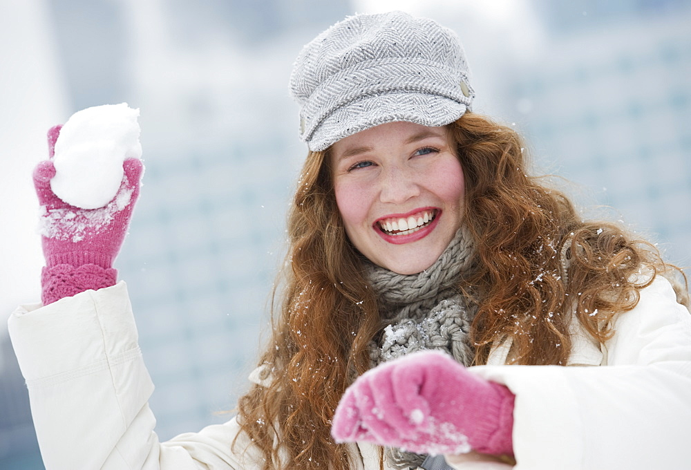 Woman throwing a snowball