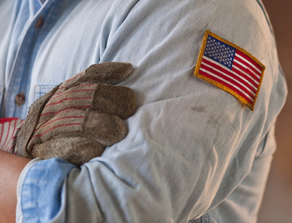 Blue collar working wearing American flag patch