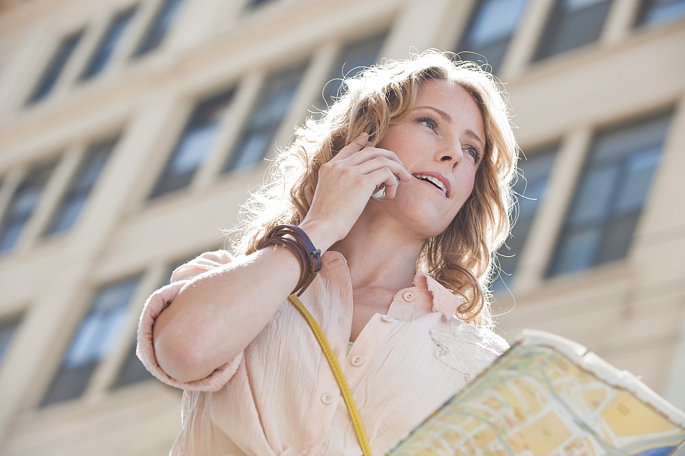 Woman outdoors with a map