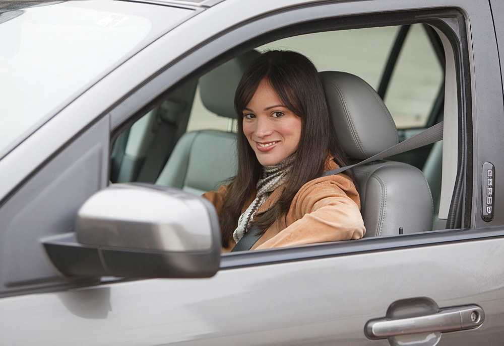Portrait of woman driving car