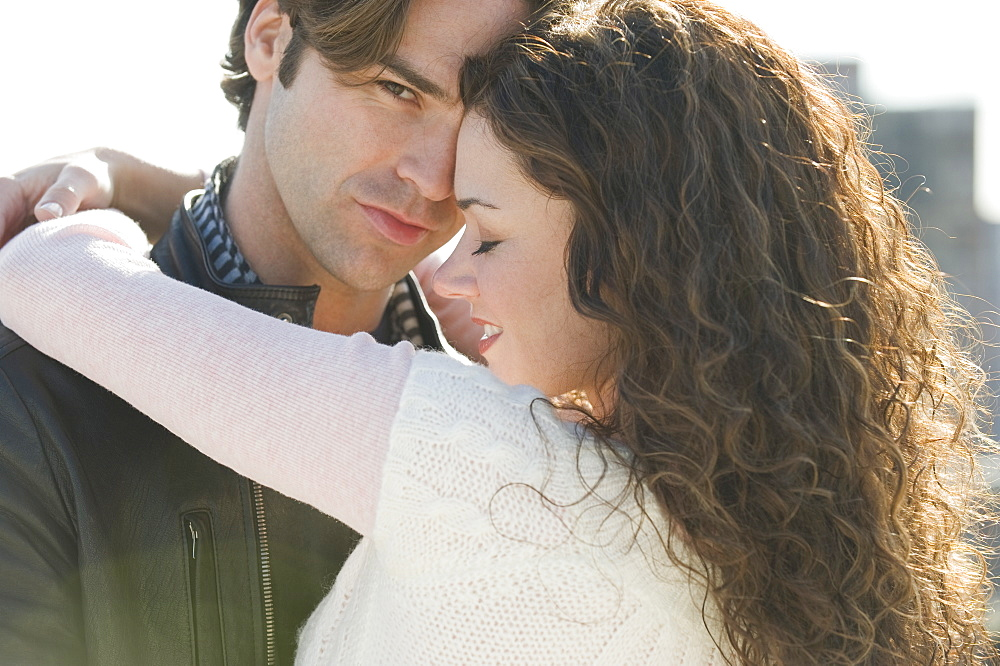 Close up of couple hugging