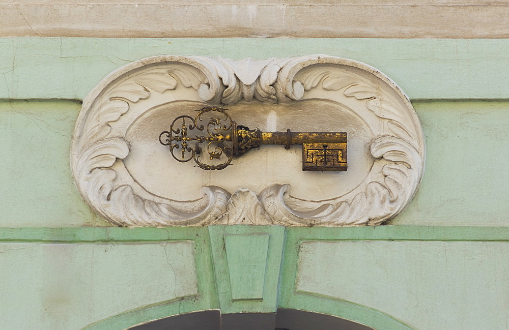 Gold key plaque to identify house, Prague