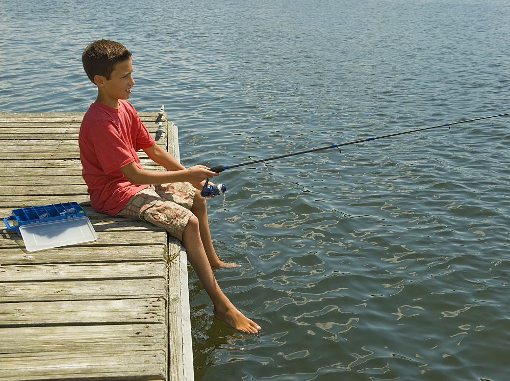 Boy fishing off dock