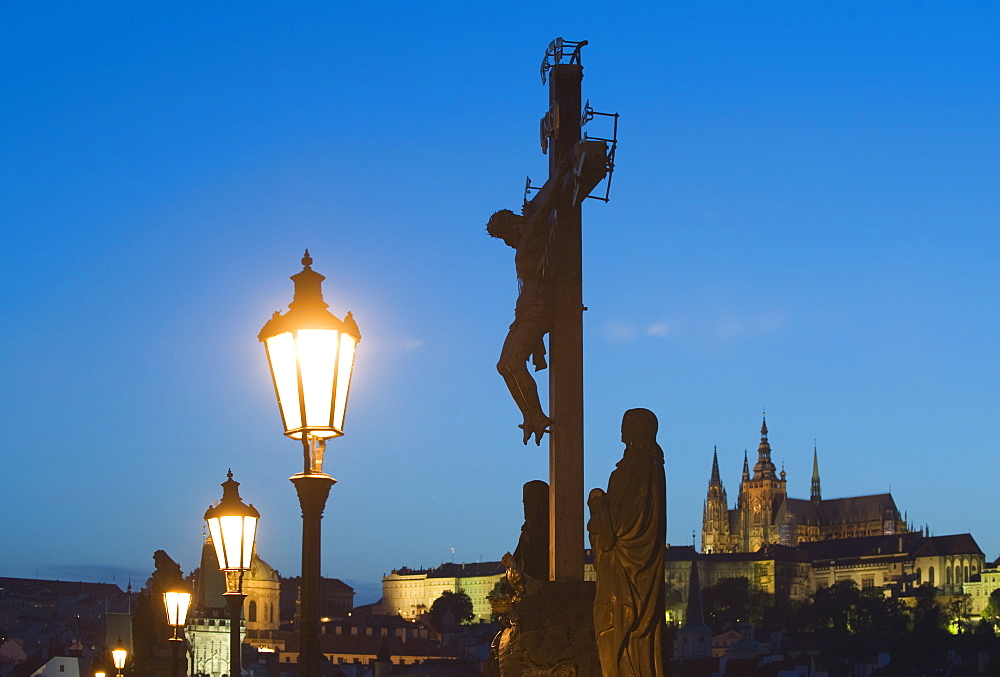 Night view of crucifix and cathedral