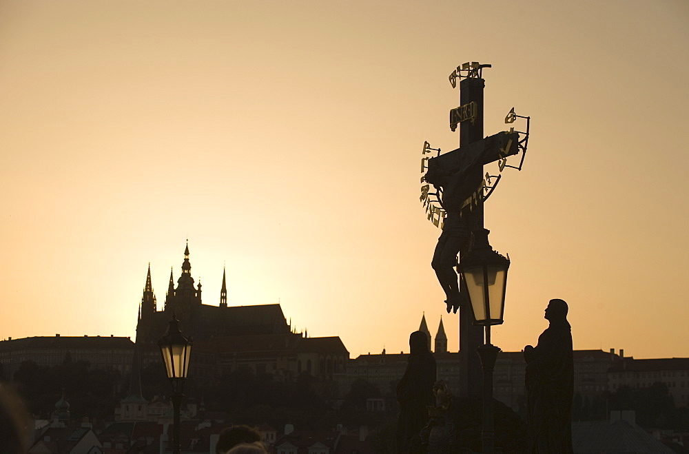 Silhouetted crucifix and cathedral