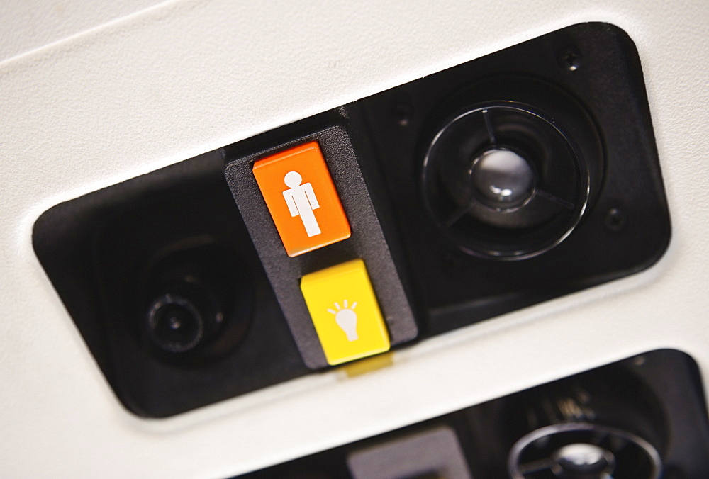 Close up of airplane call button