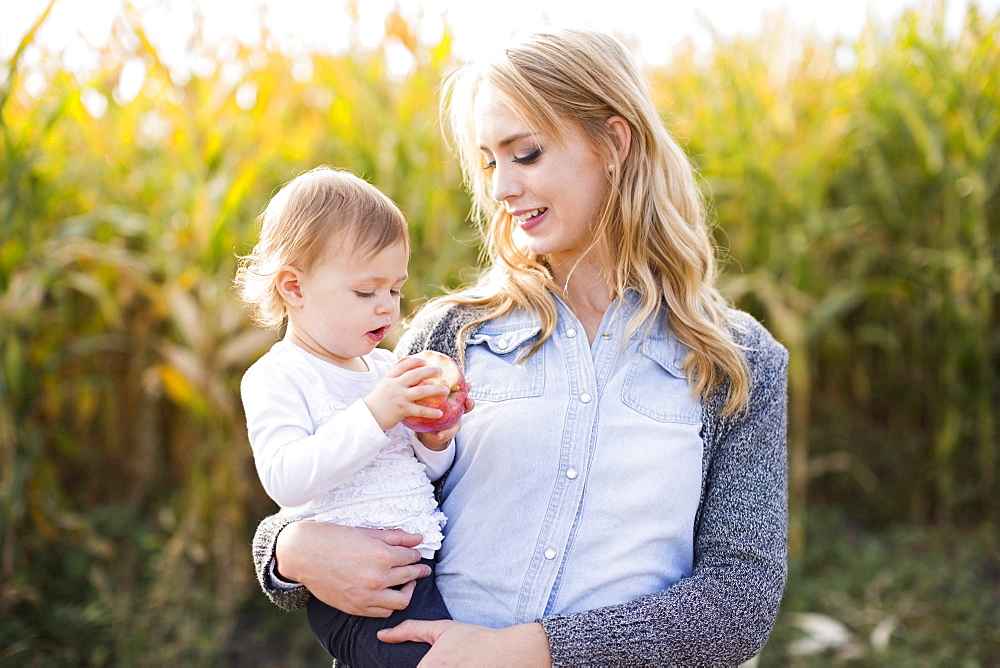 Portrait of mother and daughter (12-17 months) in field
