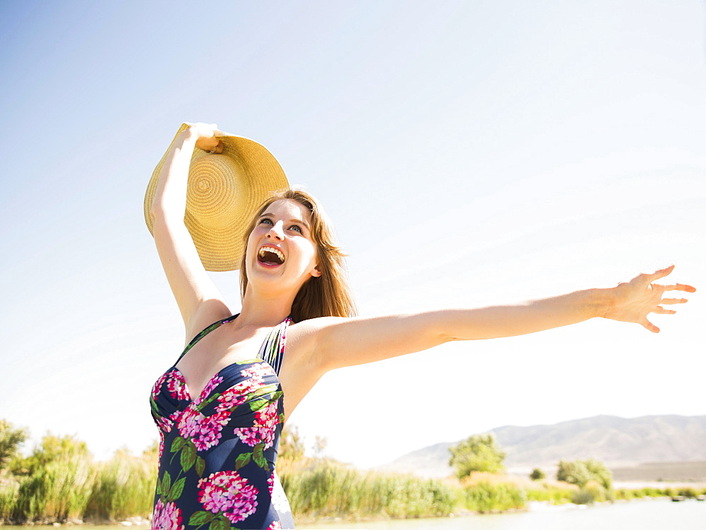 Young woman with sun hat on beach, Salt Lake City, Utah, USA