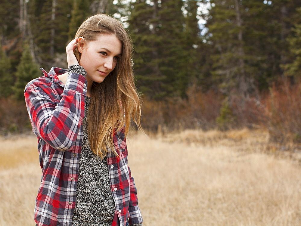 Portrait of young woman in non-urban scene, Salt Lake City, Utah