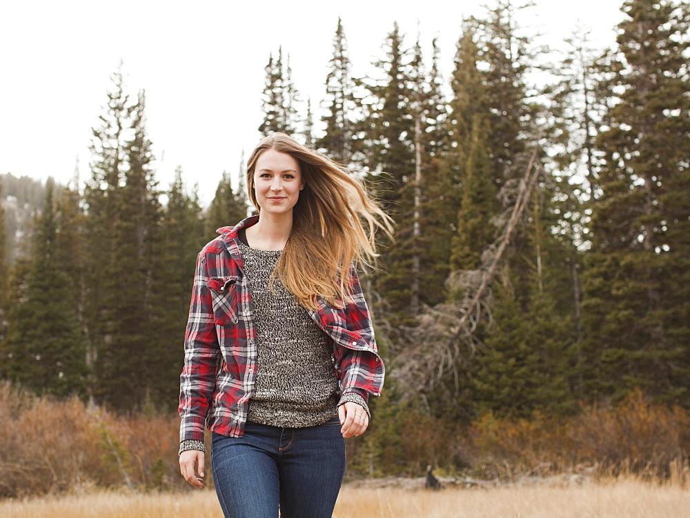 Portrait of young woman walking in non-urban scene, Salt Lake City, Utah