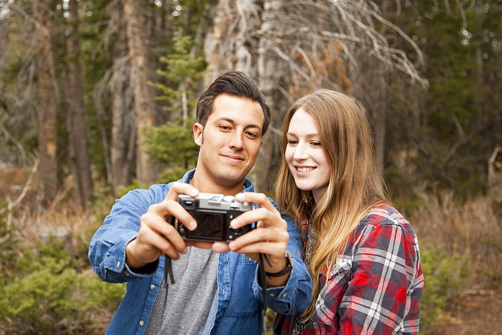 Young couple self photographing in non-urban scene, Salt Lake City, Utah