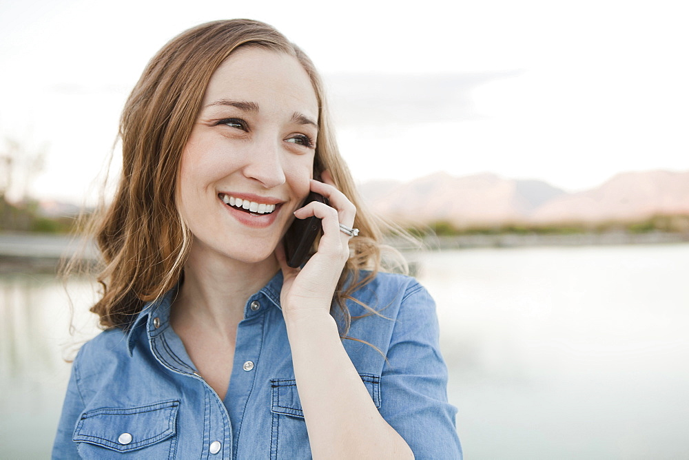 Portrait of young woman talking on phone, Salt Lake City, Utah
