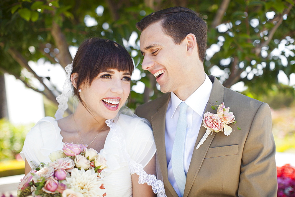 Portrait of young bride and groom