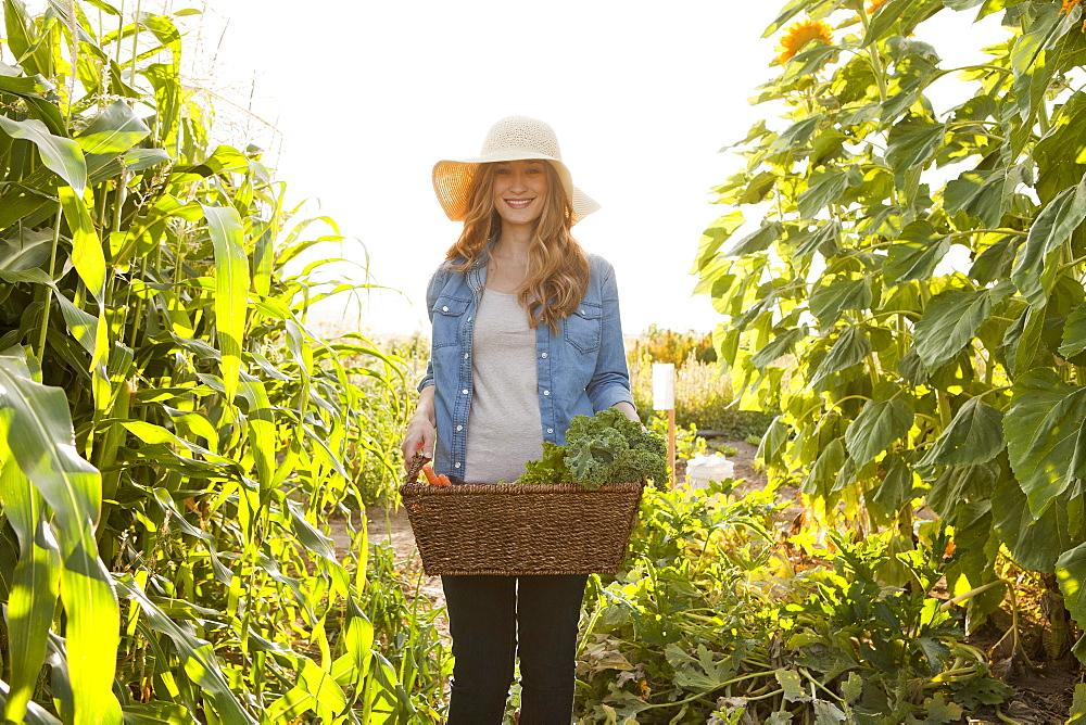 Young woman gardening, Salt Lake City, Utah