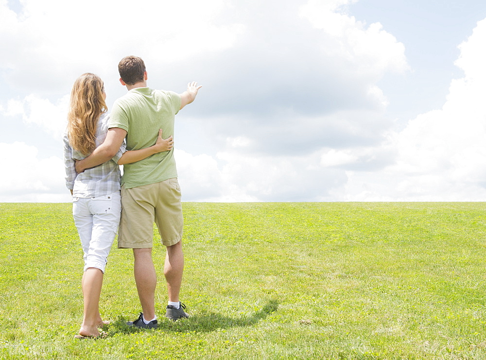 Couple standing on grass and embracing, USA, New Jersey, Mendham
