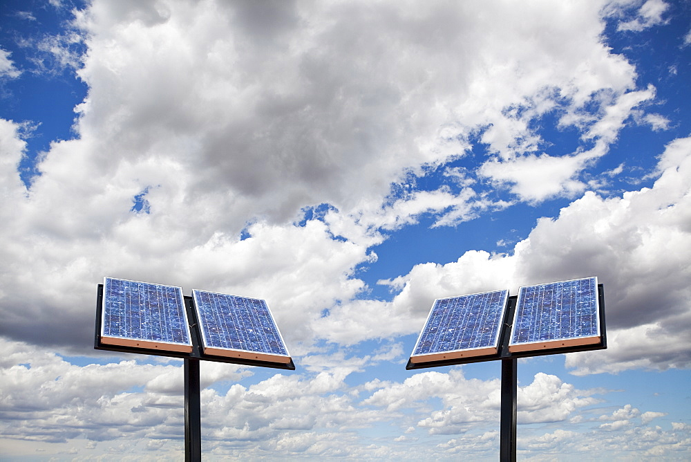 Two solar panels on sky background