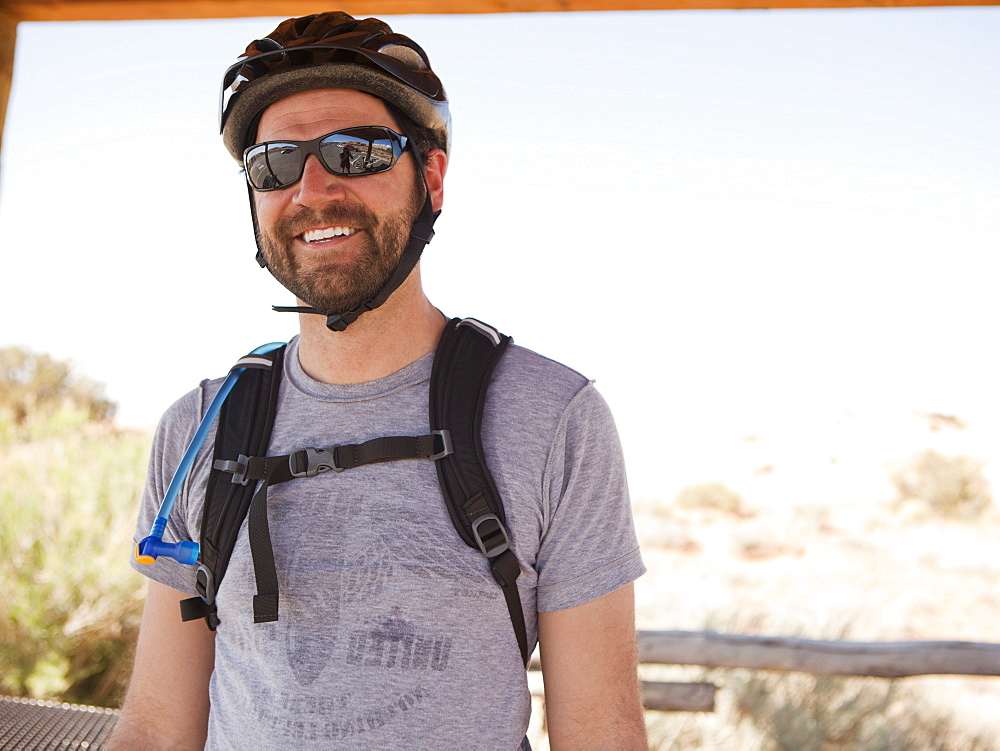 Mid adult man posing in cycling gear