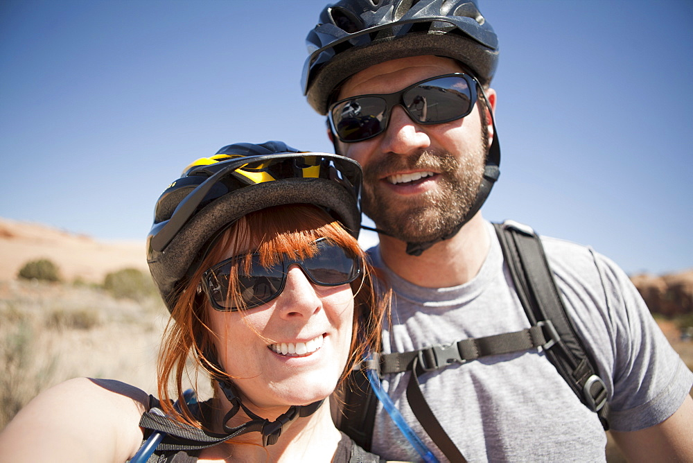 Outdoors portrait of couple in cycling gear