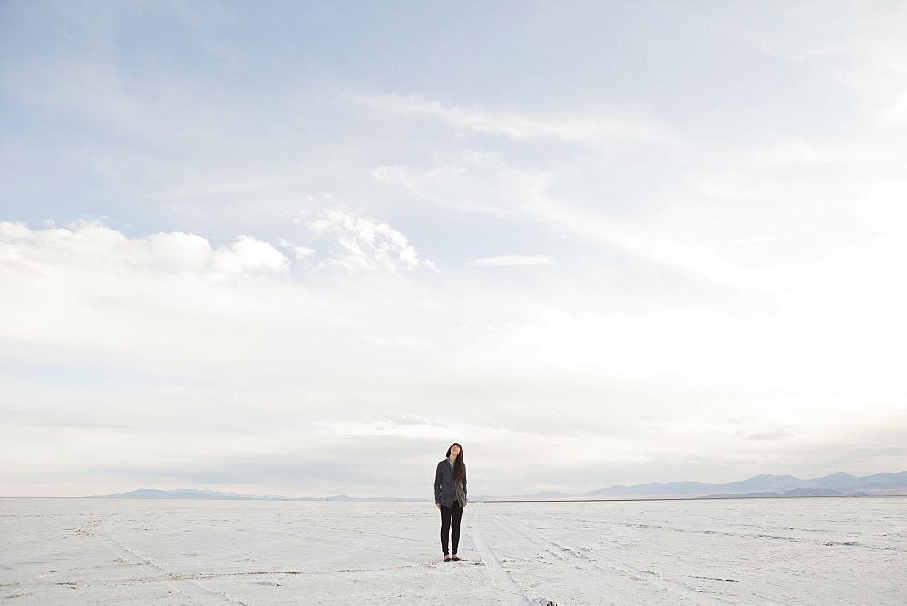 USA, Utah, Salt Lake City, Young woman standing on desert, USA, Utah, Salt Lake City