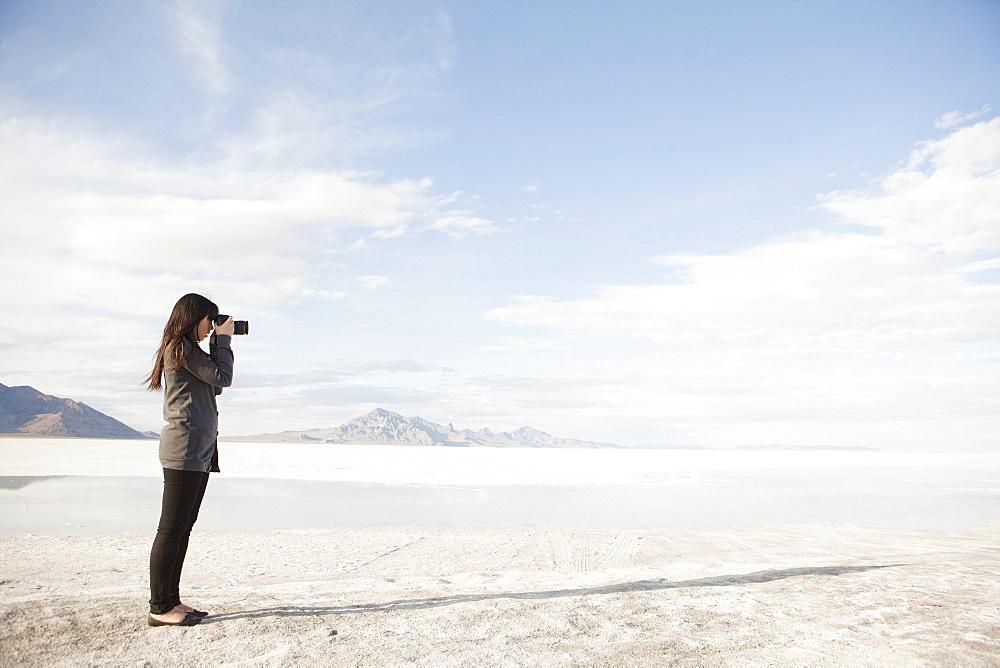 USA, Utah, Salt Lake City, Young woman taking photos, USA, Utah, Salt Lake City