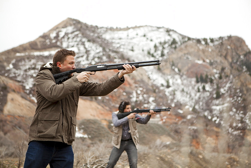 Men in mountains shooting