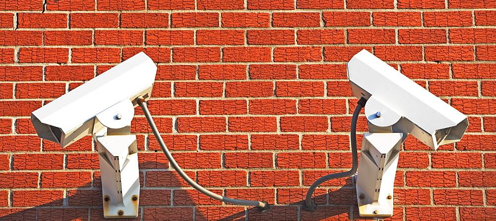 Security cameras on brick wall